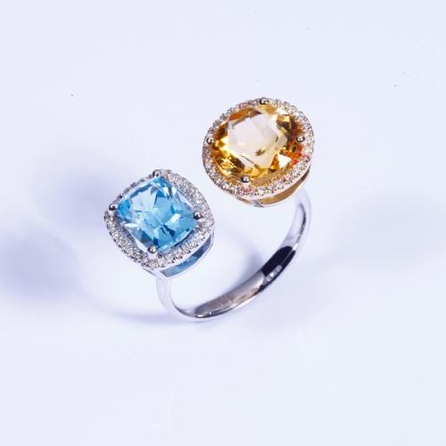 Кольцо из белого золота с топазом и цитрином